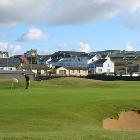 The hotel is within a 9 iron of the first tee of the Lahinch Golf Club.  We are the white building on the right.